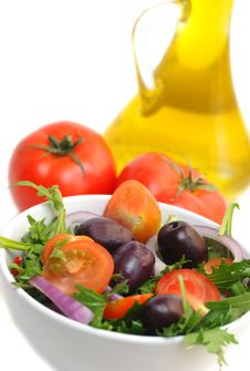 Salad With Cherry Tomatoes, Onion And Olives Stock Photo