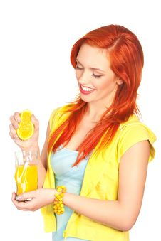 Free Young Woman Squeezes Out Orange Juice Stock Image - 14051061