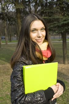 Free Female In The Park With A Folder Royalty Free Stock Photos - 14052398
