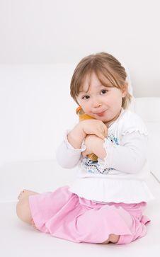 Happy Girl On Sofa Royalty Free Stock Photos