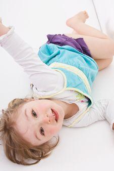 Happy Girl On Sofa Royalty Free Stock Photography