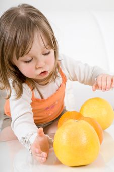 Little Girl With Fruits Stock Image