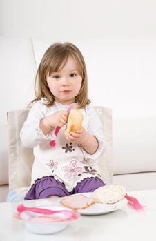Free Little Girl Eating Stock Photography - 14054302