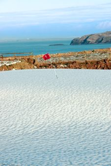 White Snow Covered Golf Course And Cliffs Stock Photo