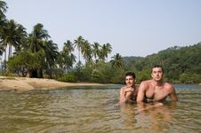 Free Two Men In Jungle Lagoon Royalty Free Stock Photos - 14055818