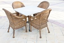 Brown Wooden Chairs An Tables On Patio Royalty Free Stock Photos