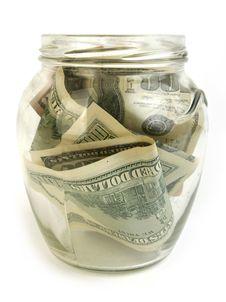 Dollar  Bills In Glass Jar Stock Photo