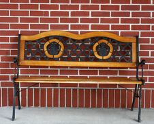 Bench On Brick Wall Stock Photography