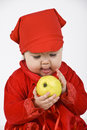 Free Baby Girl Holding And Caress An Apple Royalty Free Stock Photography - 14064427