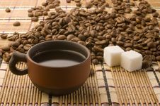 Free A Cup Of Coffee And Sugar Cubes Among Coffee Beans Royalty Free Stock Photography - 14060947