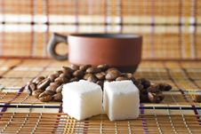Free A Cup Of Coffee, Sugar Cubes And Coffee Beans Royalty Free Stock Image - 14060986