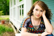 Free Teenage Girl Relaxing By The Porch Royalty Free Stock Photos - 14063558