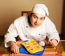 Handsome Young Chef In The Living Room With Cake O Stock Image