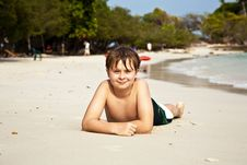 Happy Boy Lying At The Beach Royalty Free Stock Photo