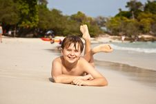 Free Happy Boy Lying At The Beach Stock Image - 14064911