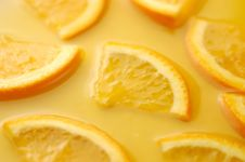 Free Orange Slices In Juice Royalty Free Stock Photography - 14066437