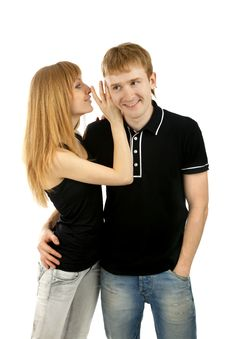 Free Beautiful Woman Whispering To A Happy Man Royalty Free Stock Photos - 14072038