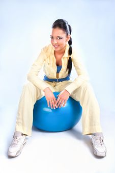 Beautiful  Girl Sitting  On The Big Blue Ball Stock Photography