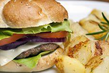 Hamburger With Roasted Potatoes Royalty Free Stock Images