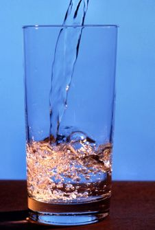 Free Water Pouring Into A Glass Royalty Free Stock Image - 14076916