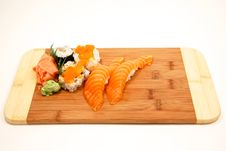 Fresh Sushi On Cutting Board Royalty Free Stock Photo