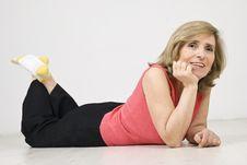 Senior Woman Lying Down On Parquet Royalty Free Stock Photo