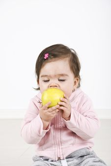 Baby Enjoying An Apple Royalty Free Stock Images