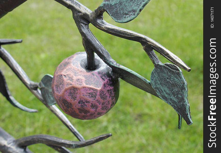 Metal forged branch with apple