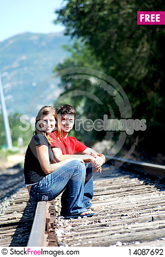 Free Couple Holding Hands On Railroad Stock Photography - 14087692