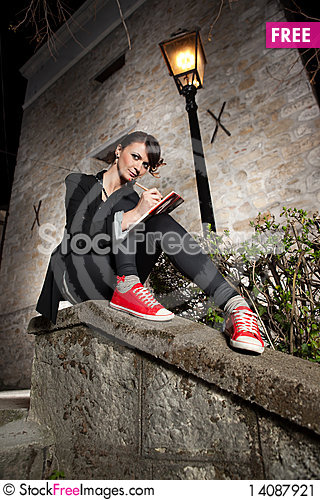 Free Beautiful Young Girl Sitting On The Wall Stock Image - 14087921