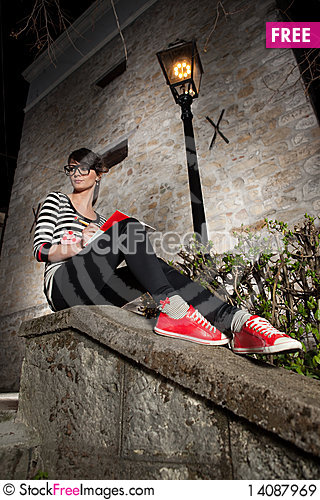 Free Beautiful Young Girl Sitting On The Wall Royalty Free Stock Images - 14087969