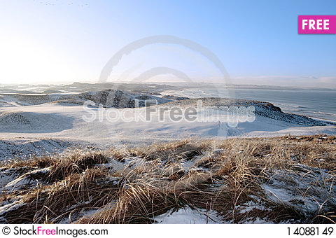 Free Icy Snow Covered Links Golf Course And Sea Royalty Free Stock Images - 14088149