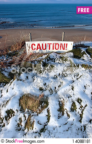 Free Red Caution Sign On Cliffs Dangerous Edge Stock Image - 14088181