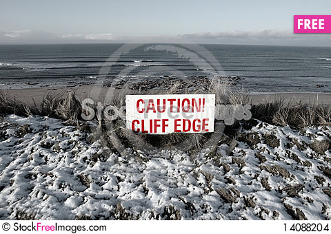 Free Red Caution Sign On Cliffs Slippery Edge Stock Images - 14088204