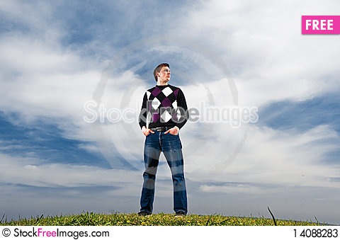 Free Young Man In The Clouds On The Green Grass Stock Photos - 14088283