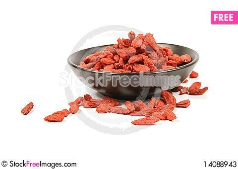 Free Goji Berries In A Black Dish Stock Photos - 14088943