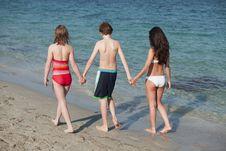 Free Teenagers Walking Along Beach Shoreline Royalty Free Stock Photo - 14084605