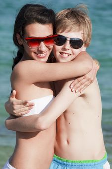 Teenagers Hugging On The Beach