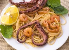 Pasta With Seafood: Octopus, Squid And Prawns Stock Image
