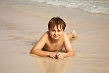 Free Boy Is Lying At The Beautiful Beach Royalty Free Stock Photo - 14087045