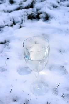 Glass Of Water In Snow Royalty Free Stock Photo
