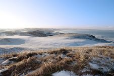 Icy Snow Covered Links Golf Course And Sea Royalty Free Stock Images