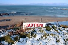Free Red Caution Sign On Cliffs Dangerous Slippery Edge Royalty Free Stock Photo - 14088195