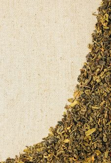 Free Dry Green Tea Leaves On A Sackcloth Royalty Free Stock Photos - 14088468