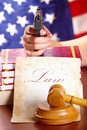 Free Hand With Gun And Judges Gavel Royalty Free Stock Image - 14092106