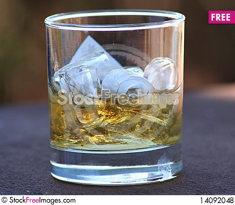 Free Whiskey In A Glass Royalty Free Stock Photos - 14092048