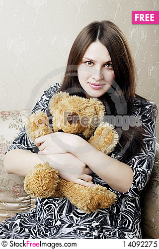 Free Pregnant Woman Sitting On A Vintage Couch Royalty Free Stock Photo - 14092275