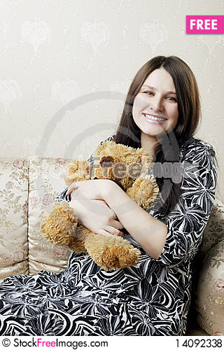 Free Pregnant Woman Sitting On A Vintage Couch Royalty Free Stock Photos - 14092338