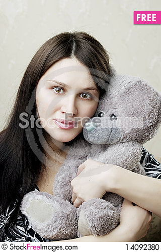 Free Pregnant Woman Sitting On A Vintage Couch Stock Photo - 14092380