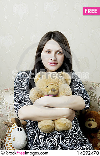 Free Pregnant Woman Sitting On A Vintage Couch Stock Photo - 14092470